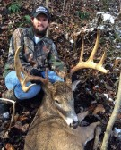 """Ethan McCallister of Logan with the buck he nicknamed """"New Boy"""" when he first saw him in 2009."""