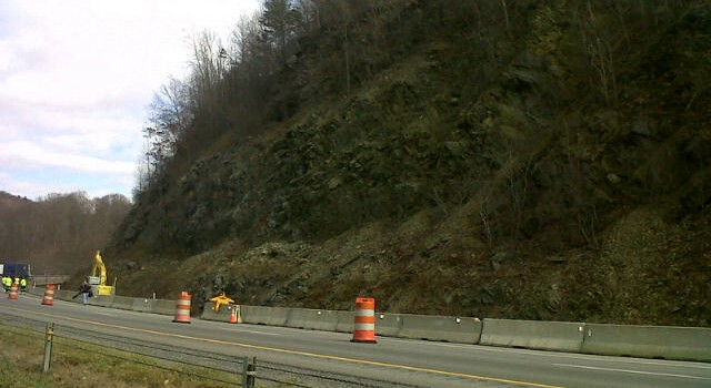 The state Department of Highways has hired a contractor to blast this area of I-77 in Mercer County—just above the northbound lanes—to prevent the odds of a rockslide.