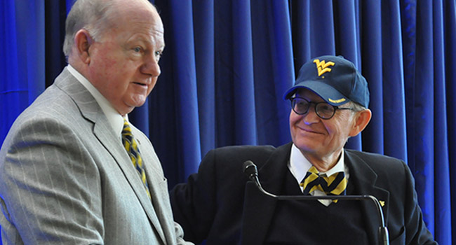 Dr. E. Gordon Gee (right) took over as WVU's president two months ago.  It was supposed to be a temporary gig.