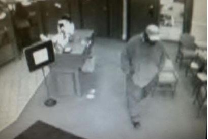 Police released a surveillance photo of one of the suspects in Tuesday's bank robbery.