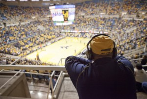 A West Virginia fan looks on from the upper level during Purdue's 73-70 victory.