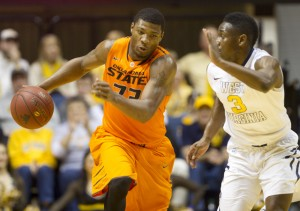 Oklahoma State's Marcus Smart scored 23 and Juwan Staten poured in 20 during their first meeting in Morgantown on Jan. 11. The Big 12's top point guards match up again Saturday in Stillwater.