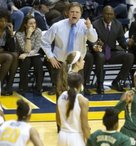 WVU coach Mike Carey yells instructions during a 78-62 loss to Baylor, the Mountaineers' only loss in their last 17 games.