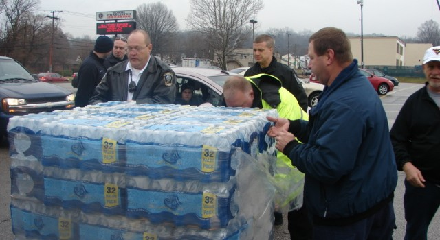 Residents come to a water distribution point in Kanawha County after a do-not-use order was issued to American Water Company customers.