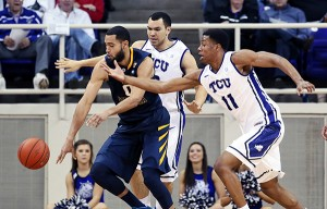 West Virginia forward Re'mi Dibo battles TCU Horned Frogs forward Brandon Parrish (11) for a loose ball during the first half at Daniel-Meyer Coliseum.