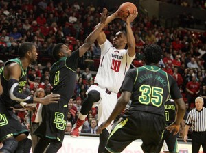 Texas Tech forward Jaye Crockett shoots against Baylor's Gary Franklin (4) during the Red Raiders' 82-72 upset win at United Spirit Arena last week.