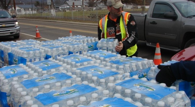Volunteers at the Marmet water distribution location in eastern Kanawha County have handed 16 tractor trailer loads of water in less than a week.