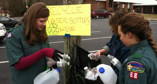 Members of Venturing Crew 68 in Cross Lanes accept water bottles to be recycled as millions of bottles have been distributed across the region.