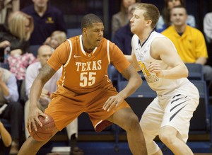 Texas center Cameron Ridley backs down WVU's Kevin Noreen during Monday night's game in Morgantown.