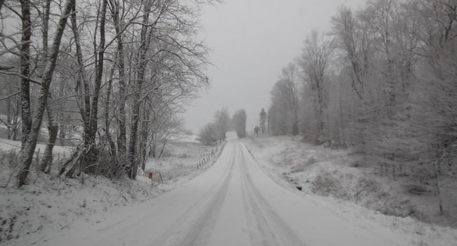 Snow covered West Virginia Friday morning. This Randolph County road is an example of difficult driving conditions.