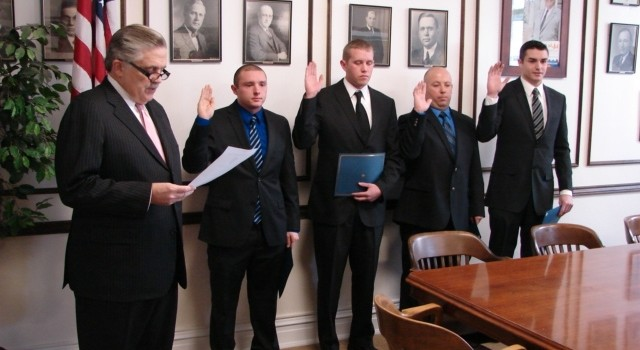 Charleston Mayor Danny Jones swore-in four new police officers Friday including Ryan Marks, a native of New York City, who said becoming an officer is a dream come true.