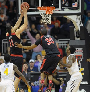 Texas Tech's Dejan Kravic (11) puts back the winning basket with 0.4 seconds left against West Virginia during the first round of the Big 12 tournament last March.