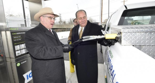 Gov. Earl Ray Tomblin, right, helped fill up a truck with compressed natural gas Tuesday morning in Charleston.