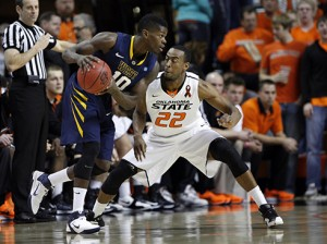 West Virginia and Eron Harris (10) hope for some payback Saturday against Markel Brown and Oklahoma State at Gallagher-Iba Arena in Stillwater.