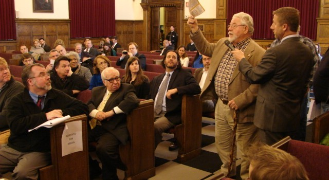 Poca Mayor Jim Caruthers, right speaking into microphone, wanted some answers at Monday's hearing.
