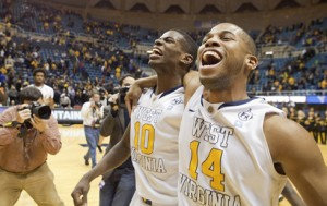 After a 28-point night that led to a 91-86 upset of Oklahoma, Eron Harris (10) celebrated with teammate Gary Browne.