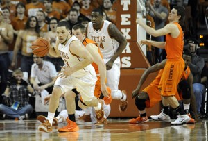 Texas guard Javan Felix (3) leads a fast break against Oklahoma State during the Longhorns' 87-68 win Tuesday.