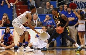 Andrew Wiggins allowed Eron Harris to hit three 3s in the first nine minutes and then held the West Virginia guard without a basket the rest of the game.