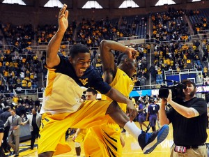Juwan Staten celebrates with walk-on Tyrone Hughes after scoring 35 points in West Virgijnia's 81-71 win over Kansas State.