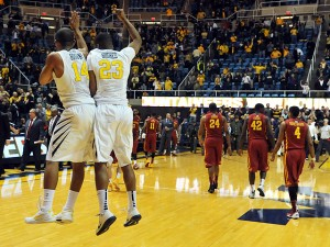 Gary Browne and walk-on Tyrone Hughes celebrated West Virginia's stunningly easy 102-77 win over No. 11 Iowa State on Monday night.