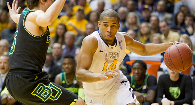 West Virginia guard Gary Browne drives against Baylor's Brady Heslip.
