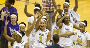 The West Virginia women's basketball team topped the Big 12's latest APR with a near-perfect four-year score of 991.