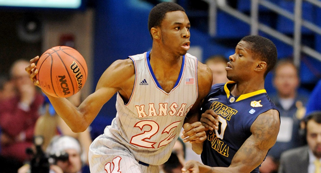 Kansas Jayhaw guard Andrew Wiggins passes the ball against West Virginia guard Eron Harris during the first half at Allen Fieldhouse.