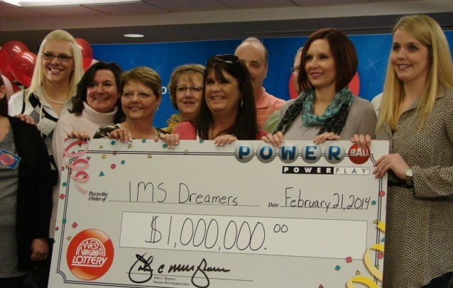 The winning group dubbed the 'IMS Dreamers' collected their money Friday at West Virginia Lottery headquarters in Charleston.