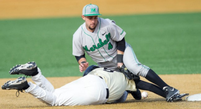Sergio Leon (4) of the Marshall Thundering Herd can't handle a pick-off throw as Evan Stephens (5) of the Wake Forest Demon Deacons slides head-first into second base at Wake Forest Baseball Park on February 17, 2014 in Winston-Salem, North Carolina. The Demon Deacons defeated the Thundering Herd 4-3.