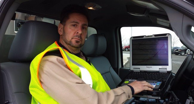 Mon Power lineman Robert Garcia shows off new computers that will assist company line crews.