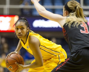 Taylor Palmer looks to pass during No. 11 West Virginia's 69-37 win over Texas Tech.