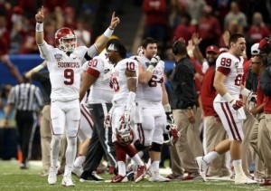 Oklahoma Sooners quarterback Trevor Knight (9) and teammates celebrate after the Sooners recovered the ball on an on side kick against the Alabama Crimson Tide in the fourth quarter at the Mercedes-Benz Superdome. Oklahoma defeated Alabama 45-31.