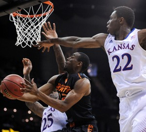 Oklahoma State's Markel Brown, hawked by the defense of Andrew Wiggins (22), shot 5-of-13 in a 77-70 overtime loss to Kansas.
