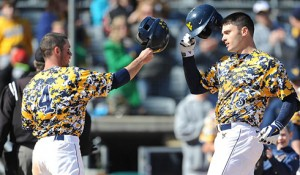 West Virginia's Ryan McBroom, right, celebrates his tiebreaking two-run homer in Sunday's 4-1 win over Baylor.