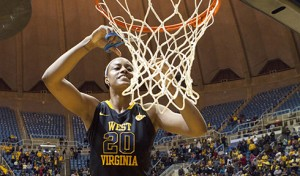 West Virginia's Asya Bussie cuts down the nets after the Mountaineers won a share of the Big 12 regular-season title by beating Kansas 67-60 on March 7.