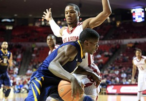 West Virginia guard Eron Harris picked up two fouls and went 0-of-3 shooting in the opening half at Oklahoma.
