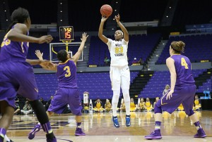 Though West Virginia guard Bria Holmes (23) missed 11-of-12 shots from 3-point range against Albany, coach Mike Carey encourages her to keep firing when the Mountaineers face LSU in Tuesday night's second-round NCAA game.