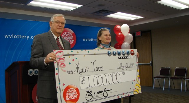 Ritchie County resident Katie Ivers used numbers from her atomic clock for the recent Powerball drawing. She picked up her big winnings Monday from WV Lottery Director John Musgrave.