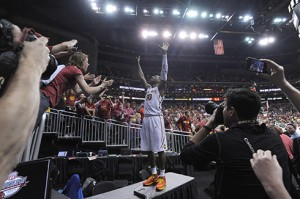 Former Marshall guard DeAndre Kane (50) celebrates with Iowa State fans after a 74-65 win over Baylor in the Big 12 championship game.
