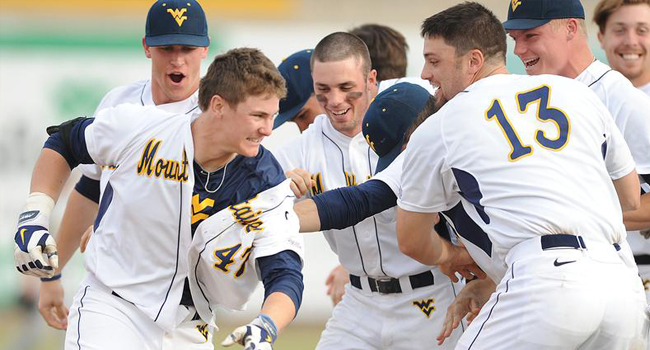 West Virginia's Jackson Cramer (47) was mobbed by teammates after his RBI double in the 12th inning lifted the Mountaineers over Baylor 8-7.