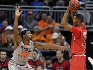 Oklahoma State guard Marcus Smart bothered exas Tech's Jaye Crockett and played an all-around dazzling game at the Big 12 Conference tournament.