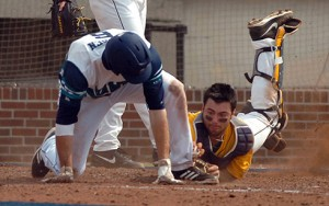 UNCW's Casey Golden scores ahead of a tag by West Virginia's Cameron O'Brien during the Seahawks' 13-10 win Sunday.