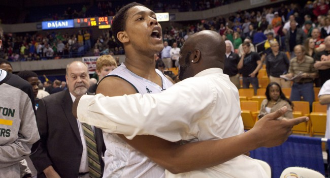 Arick Nicks celebrates after his free throw with 2.5 seconds left won the Class AAA state championship for Huntington 55-54 over Hurricane.