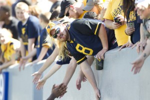 West Virginia has sold 28,800 season tickets as of midweek, a year-to-date dropoff of about x percent from 2013.
