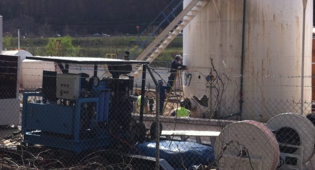 Investigators with the U.S. Chemical Safety Board began taking apart the tank that leaked MCHM Thursday.