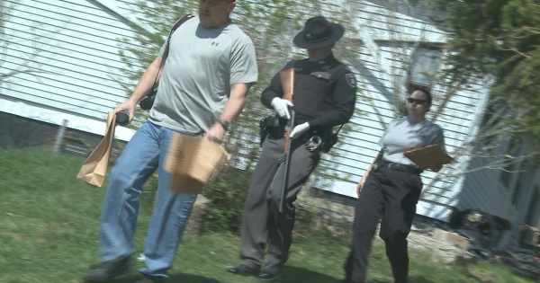 Sheriff's deputies are shown here carrying evidence out of the Putnam County residence Saturday morning.