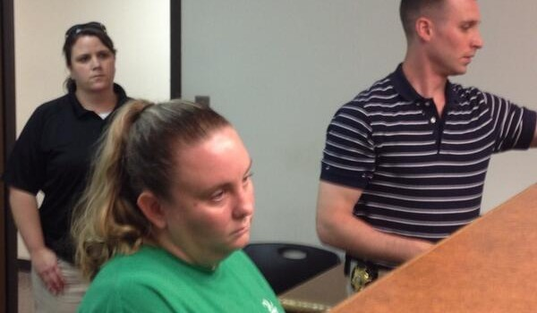 Kara Brumley (front) was arraigned in Kanawha County Magistrate Court Thursday evening.