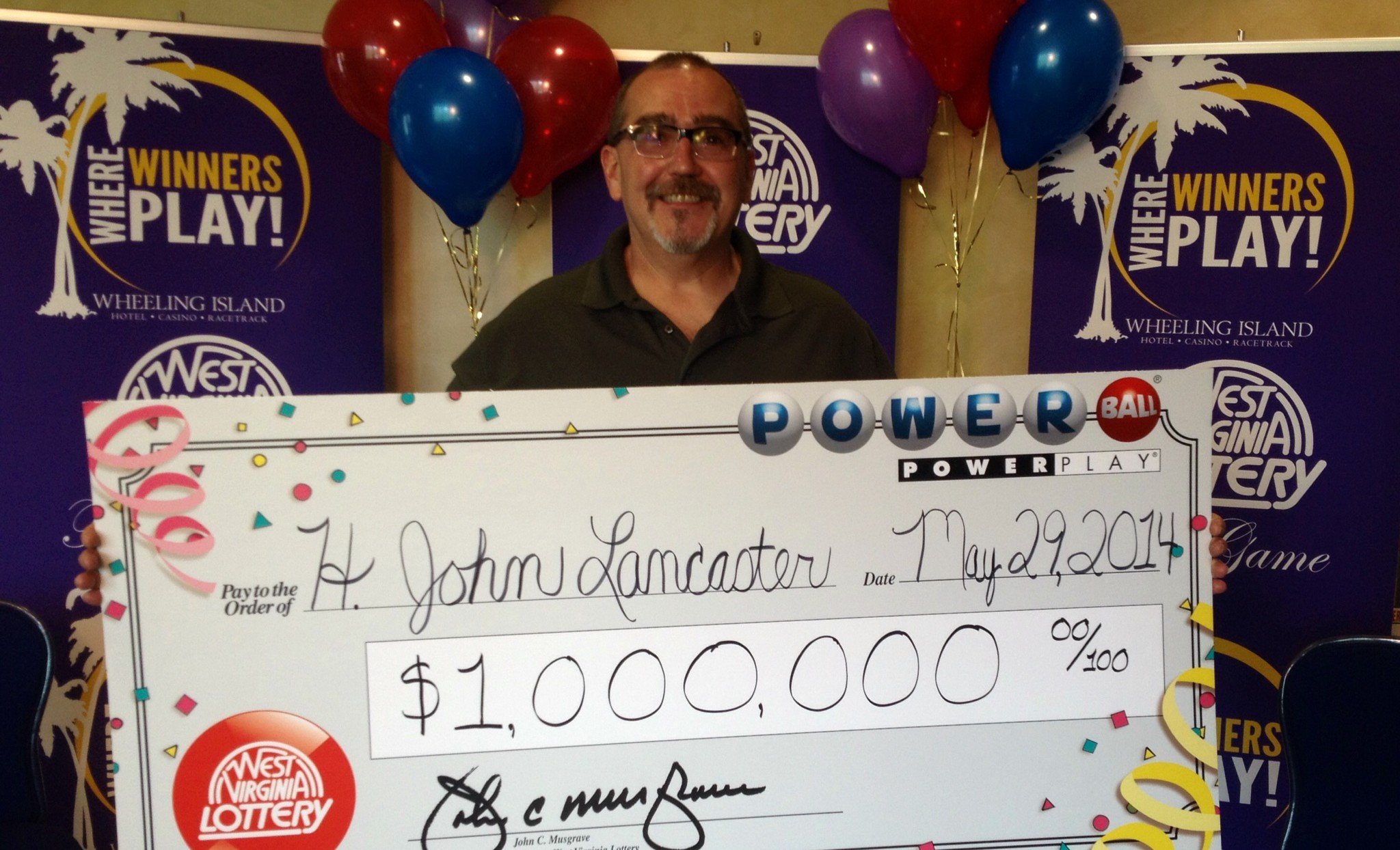 Small business owner John Lancaster says he couldn't believe it when he heard he had won.