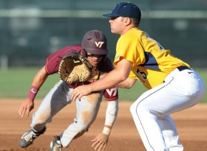 WVU first baseman Ryan McBroom fields a pickoff throw against Virginia Tech.