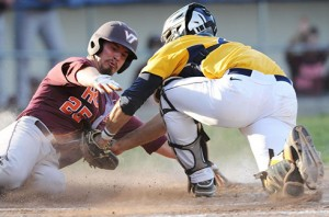 West Virginia catcher Cameron O'Brien tags out Virginia Tech's San Keselica during the fourth inning Tuesday night. WVU rallied to win 4-3.